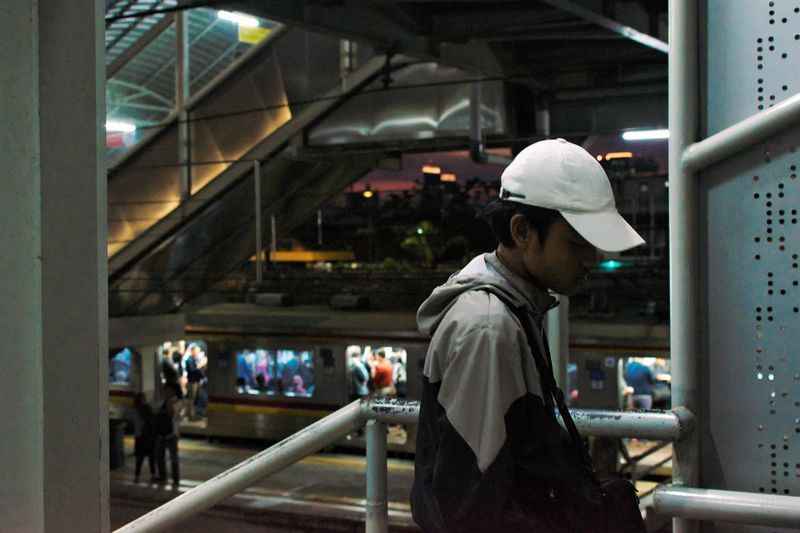 A scene in Tanah Abang station Jakarta, Indonesia. December 2017 Streetphotography Documentaryphotography Train Train Station Commuter Commuting Commuter Train Commuters Commuterline Transportation Local Transport City Transportation Candid UNPOSED Real People Illuminated One Person Waist Up Night Men Lifestyles Architecture Warm Clothing Standing Adult People Young Adult EyeEm Ready   The Street Photographer - 2018 EyeEm Awards
