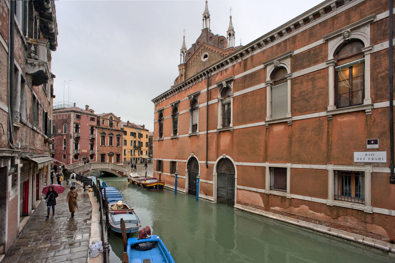 architecture, building exterior, built structure, canal, water, day, real people, city, nautical vessel, outdoors, sky, one person, people
