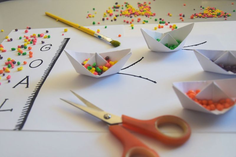 Animal Representation Art And Craft Brush Close-up Craft Creativity High Angle View Indoors  Large Group Of Objects Multi Colored No People Origami Origamiart Paintbrush Paper Paper Boat Representation Scissors Selective Focus Shape Still Life Table Together Strong