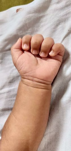 Close Palm Baby's Hand Human Hand Body Care Pampering Bed barefoot Lying Down High Angle View Toe Human Foot Close-up