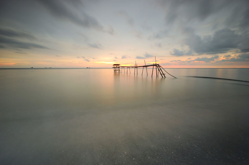 Beautiful sunrise at seascape Jetty Nature Photography No People Outdoors Pier Rock Sea Sky Sunrise Sunset Water Waves, Ocean, Nature