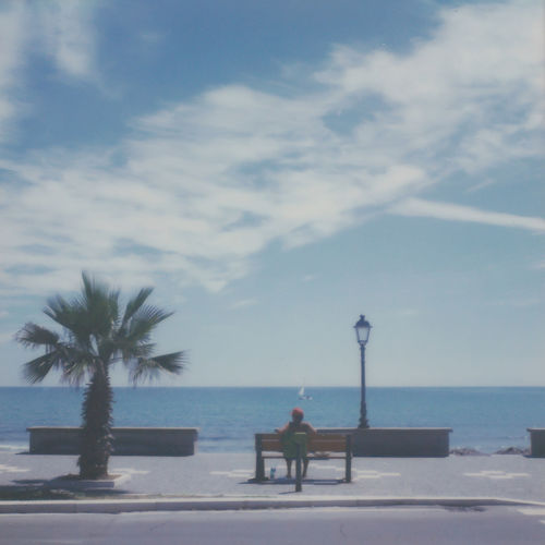 Analogue Photography Beach Beauty In Nature Cloud - Sky Day Film Photography Horizon Horizon Over Water Land Leisure Activity Nature One Person Outdoors Palm Tree Plant Polaroid Real People Scenics - Nature Sea Sky Tree Tropical Climate Water