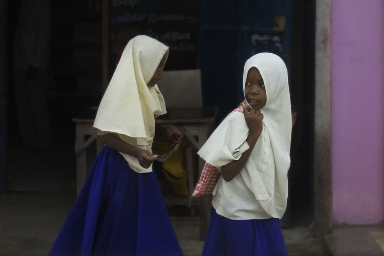 ZANZIBAR'S SCHOOL GIRLS Day Front View Indoors  Lifestyles One Person People Real People Standing Traditional Clothing Young Adult Young Women