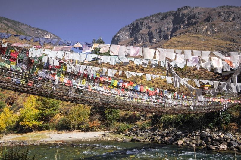 Built Structure Nature Outdoors Day Flag Bhutan Bridge Gebetsfahnen Colorful Blue Sky Religious Art Traditional Culture