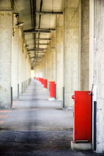 Architecture Architectural Column Red Built Structure In A Row The Way Forward No People Corridor Day Indoors