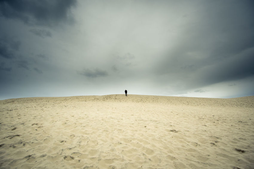 man in sand Denmark Dunes Arid Climate Beauty In Nature Cloud - Sky Day Desert Horizon Over Land Landscape Men Nature One Person Outdoors People Real People Sand Sand Dune Scenics Sky Tranquility The Week On EyeEm Lost In The Landscape Perspectives On Nature