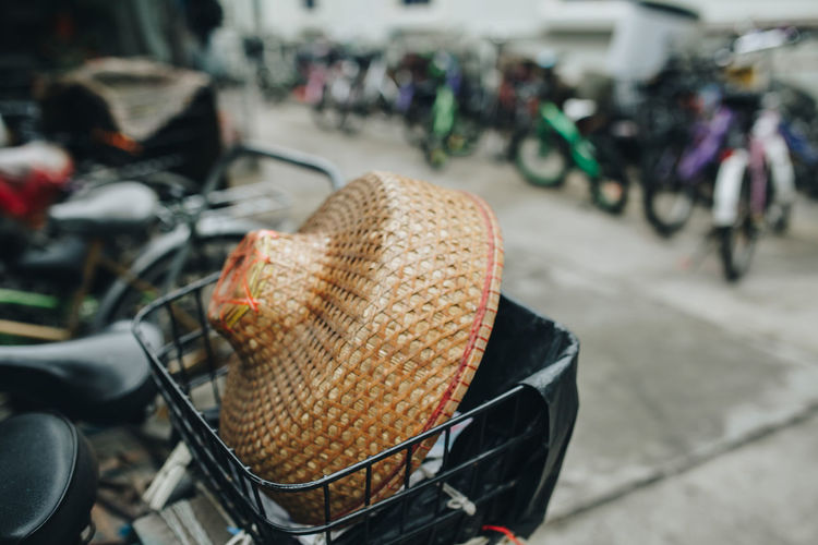 Close-up of straw hat in bicycle basket