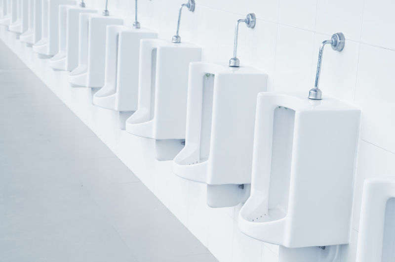 Architecture Bathroom Day Empty Hygiene In A Row Indoors  Modern Neat No People Seat Urinal White Color
