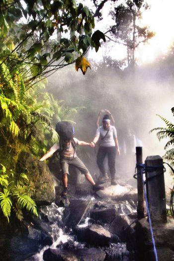 cross the gorge with hot waterfall. Outdoor Adventure Climbmountain Gede Pangrango Nature