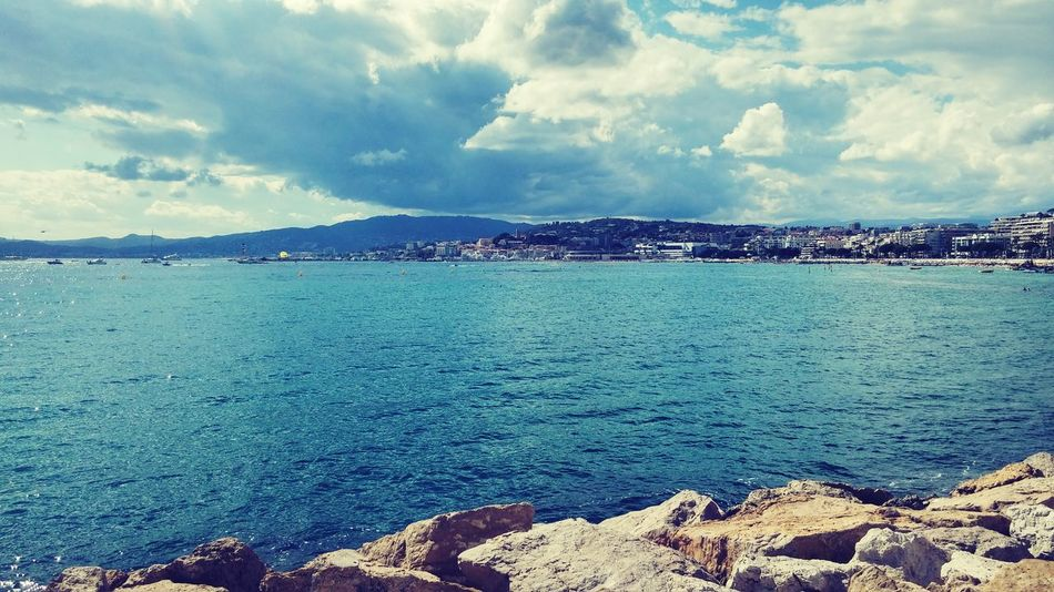 Mare Sea Nuvoloso Scogli Beach Spiaggia No People Outdoors Tranquility Beauty In Nature Water Scenics Rock - Object Tranquil Scene Cloud - Sky Sky Nature Blue Mountain Day