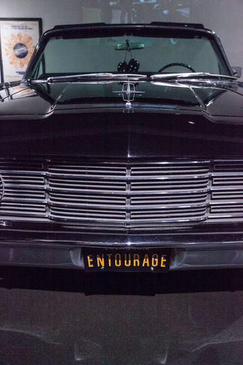 Los Angeles, CA, USA - March 4, 2017: Black 1965 Lincoln Continental driven by the character Drama in the television series Entourage from the collection of Harold and Paul Tennen at the Petersen Automotive Museum in Los Angeles, California, United States. Editorial only. 1965 Antique Black Car Car Classic Car Collector's Car Day Drama Entourage Lincoln Lincoln Continental Movie Props No People Old Car Transportation Transportation