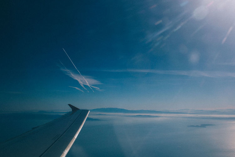 Aerial Aerial View Airplane Atmosphere Atmosphere Atmospheric Mood Clear Sky Clouds Clouds And Sky Environmental Conservation Flying Horizon Journey Light Lightroom Mid-air Mist Misty Plane Sea Sky Sky And Clouds Speed VSCO Vscofilm