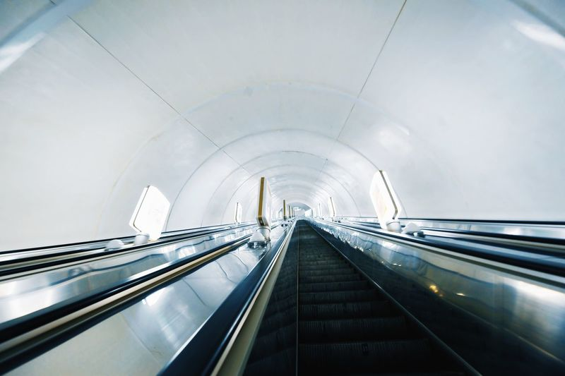 Low angle view of escalator in tunnel