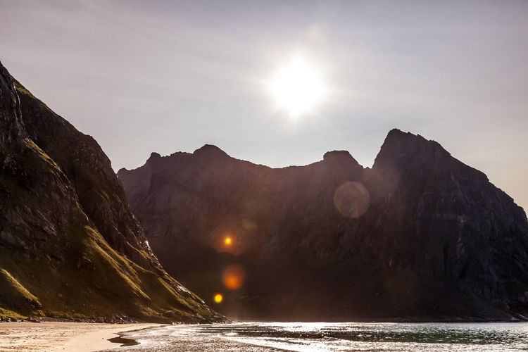 Scenic view of solar rays over a mountain in the far north of norway.