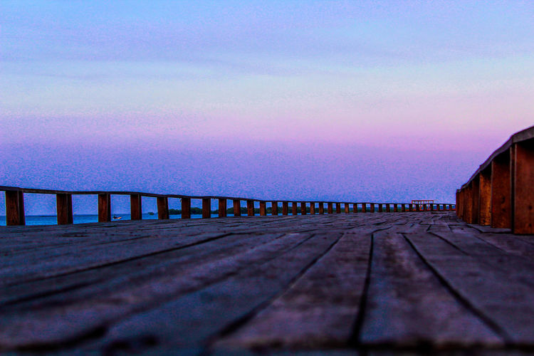 Street Sunset Wood - Material Bridge - Man Made Structure Clear Sky Sky Architecture Landscape Built Structure Wooden Post Shore Calm Mooring Post Dock