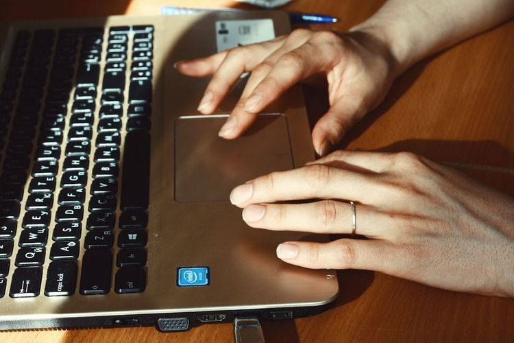 Computer work Human Hand Hand Human Body Part Technology Real People One Person Computer Keyboard Wireless Technology Connection Computer Equipment Adult Human Finger Laptop Using Laptop Body Part Computer Keyboard Indoors  Communication Finger