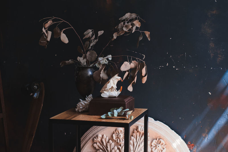 Digital composite image of man and woman sitting on table