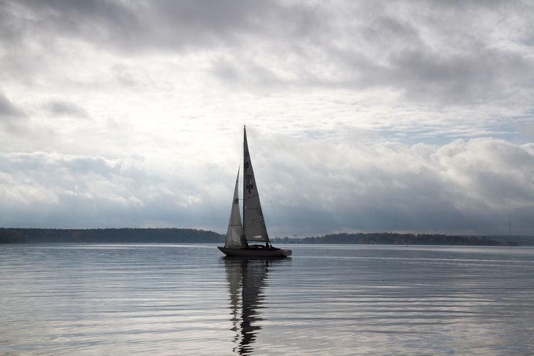 Sailboat Sailing In Lake Against Sky