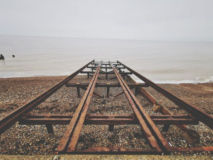 Old lifeboat launch rails dissappearing into the sea