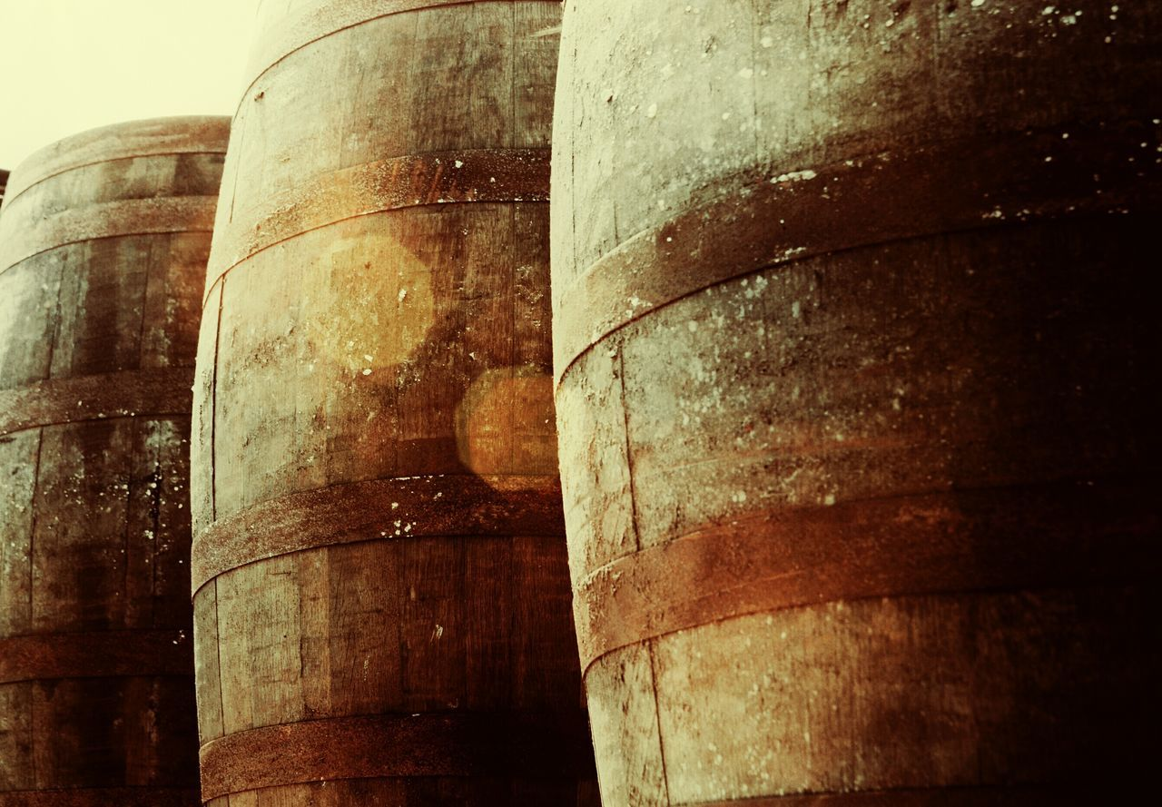barrel, cellar, wine cellar, winery, wine, no people, storage tank, wine cask, history, low angle view, architecture, built structure, architectural column, alcohol, day, winemaking, industry, indoors, basement, close-up