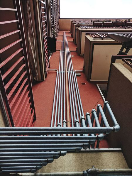 Pipes Pipe - Tube Urban Industrial Gas High Angle View Architecture Outdoors No People Day View From Below Tubes Red Façade City Residential Building Net