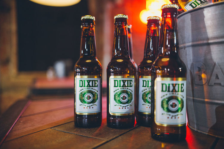 Beer Bucket Dixie Beer Dixie Pabst Blue Ribbon Bar Neon Neon Lights Container Bottle Drink Refreshment Table Food And Drink Focus On Foreground Alcohol Indoors  Still Life No People Glass - Material Close-up Transparent Bar - Drink Establishment Side By Side Glass Bar Counter Choice Beer - Alcohol