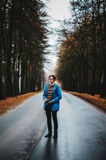 EyeEmNewHere Road Casual Clothing Diminishing Perspective Forest Full Length Jacket Nature Outdoors Photographer Portrait Road Tree Young Adult