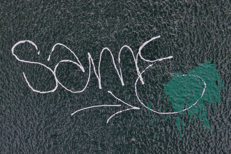 The Word Same On Glass Dark Green Color Netherlands Pain Word Dutch Glass Graffiti Art Holland Same  Vandalism