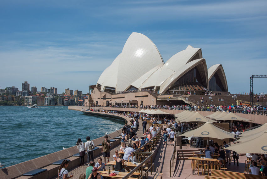 Sydney,NSW,Australia-November 20,2016: Sydney Opera House and Bar at Bennelong Point in Sydney, Australia. 20th Century Architecture Australia City Life City Break Harbour Modern Architecture Opera Bar Sydney Opera House Sydney Harbour  Tourist Bar Bennelong Point Crowd Crowded Design Large Group Of People Lifestyles Parramatta River Real People Sydney Tourism Travel Destinations Umbrella Waterfront