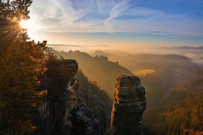 Layers In Landscape Landscape Mountain Beauty In Nature Scenics Sunlight Rock - Object Forest Outdoors Sunbeam Mountain Peak Misty Morning Misty Mountains  Sunrise Early Morning Saxon Switzerland Sächsische Schweiz Bastei Travel Destinations Hiking Hiking Adventures Sun Through The Trees Sublime Living Travel