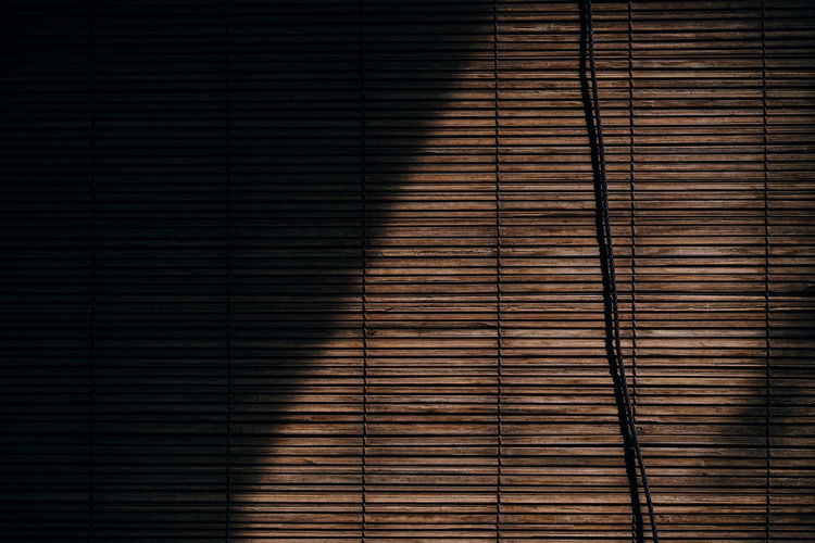 Chinese wooden chick blinds curtain hanging. Oriental traditional curtain design. Bamboo wooden curtain texture pattern for the background. Blind Tradition Architecture Backgrounds Blinds Blinds Shadows Brown Building Exterior Chick Close-up Curtain Day Full Frame Low Angle View Modern Nature No People Outdoors Pattern Repetition Shadow Sunlight Texture Textured  Window