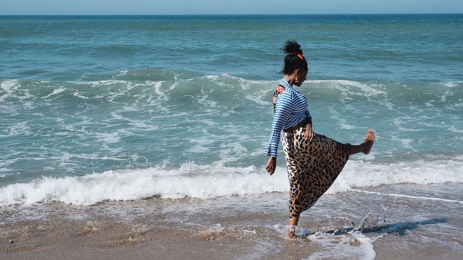 Sea Water Land Wave Beach Motion Real People Lifestyles Beauty In Nature Rear View One Person Leisure Activity Day Women Nature Casual Clothing Horizon Over Water Horizon Outdoors The Great Outdoors - 2019 EyeEm Awards