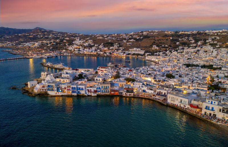 Aerial view to the town of Mykonos island after sunset, Cyclades, Greece Blue Hour Drone  Lights Vacations Aerial View Architecture Bay Building City Cityscape Cloud - Sky Cyclades Greece Harbor Illuminated Island Mykonos Sea Sky Sunset Tourism TOWNSCAPE Travel Destinations Water Waterfront