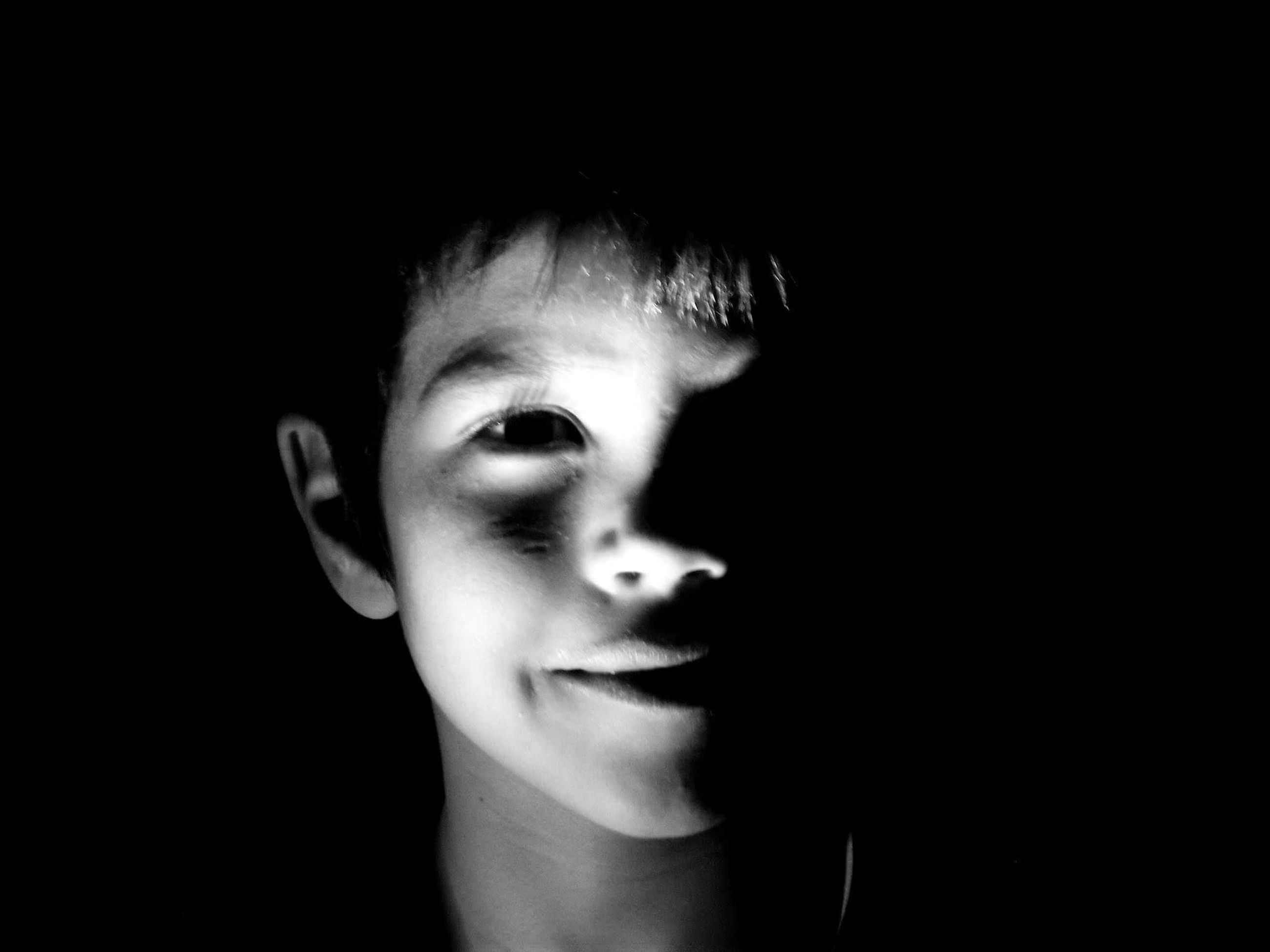 childhood, one person, real people, boys, close-up, indoors, black background, day, people