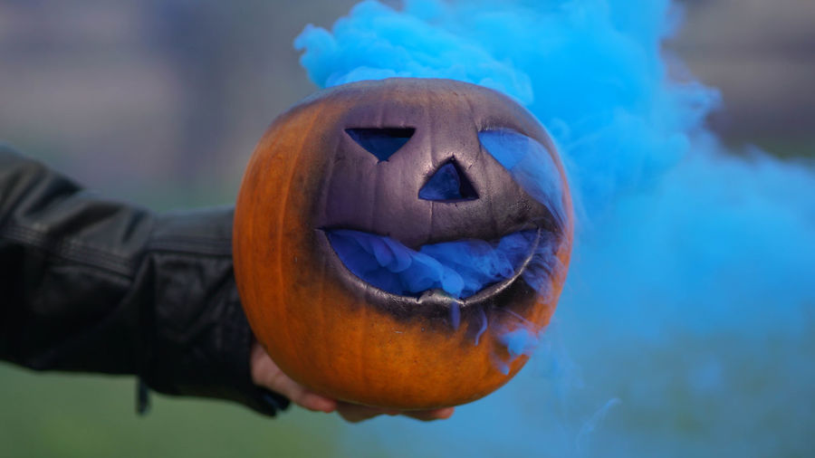 Close-up of hand holding jack o lantern