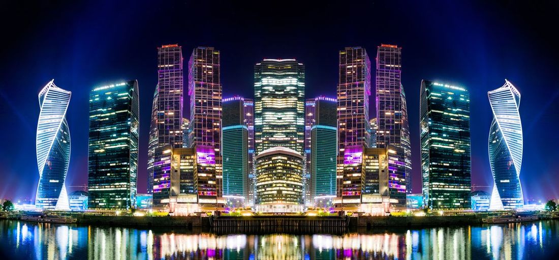 Building Exterior Architecture Built Structure Illuminated Night City Building Reflection Financial District  Nature Modern Waterfront Tall - High No People Water Office Building Exterior Skyscraper Cityscape Sky Glowing