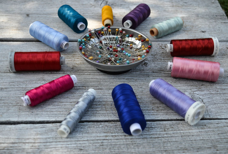 Work Art And Craft Art And Craft Equipment Choice Close-up Colorful Craft Creativity Group Of Objects High Angle View Hobby Indoors  Large Group Of Objects Multi Colored Needle No People Sewing Item Spool Still Life Table Textile Thread Threads Variation Wood - Material