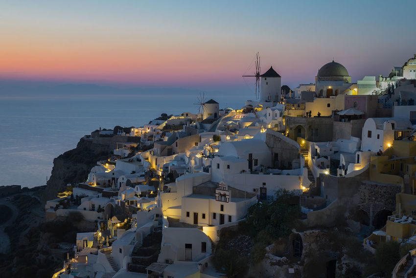 One of the most popular views of the sunset in Santorini, Greece, the go-to island for romance and sunset views Blue Ellada  Greece Hellas Island Mediterranean  Ocean Oia Oia Santorini Oia Village Oiasantorini Oiasunset Santorini Santorini Church Santorini Greece Santorini Island Santorini Sunset Santorini, Greece Sea Summer Summertime Sunset Travel Windmill Windmills HUAWEI Photo Award: After Dark