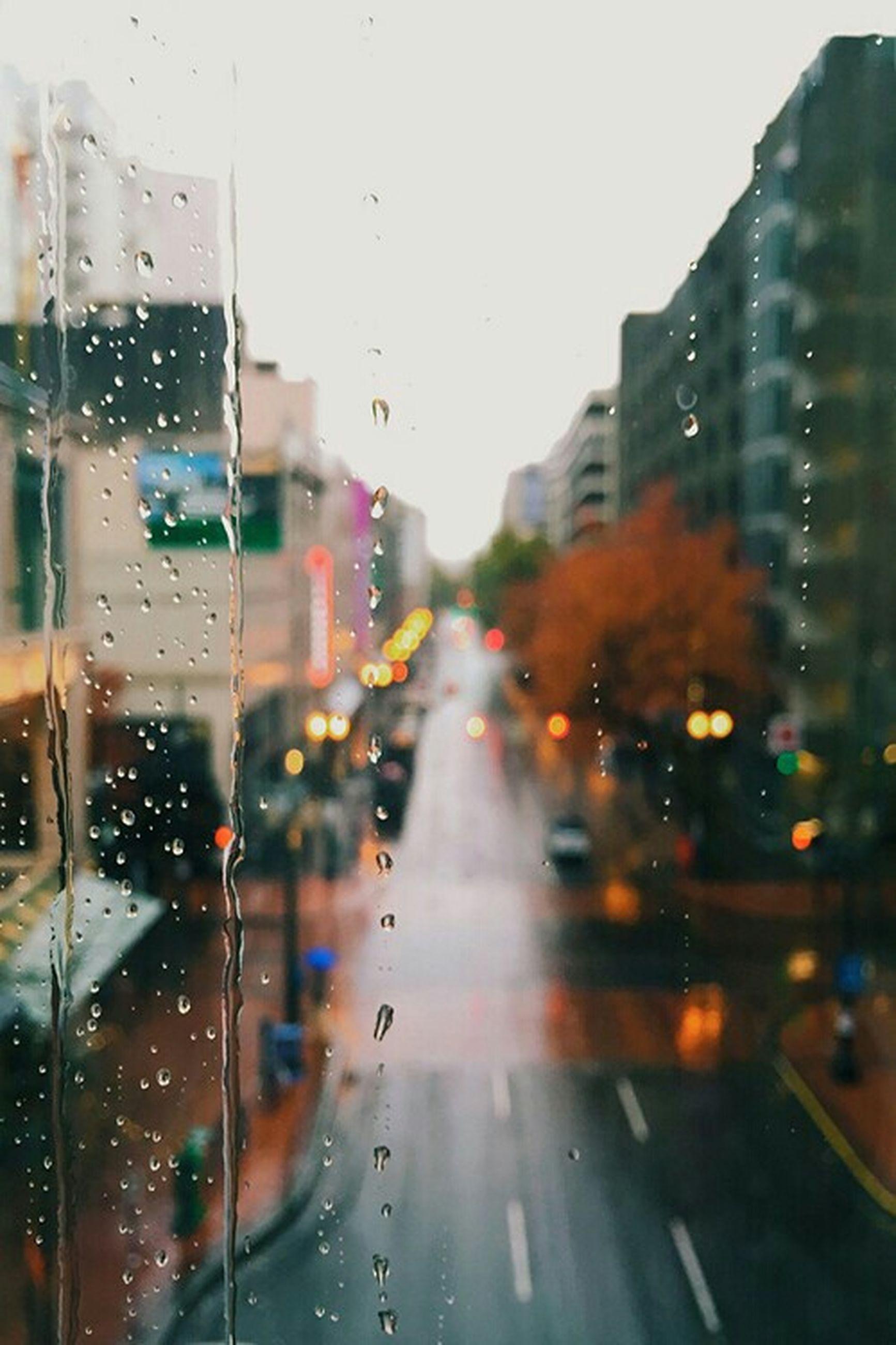 wet, transportation, drop, rain, car, window, transparent, glass - material, land vehicle, mode of transport, indoors, season, city, weather, raindrop, road, street, the way forward, built structure, architecture