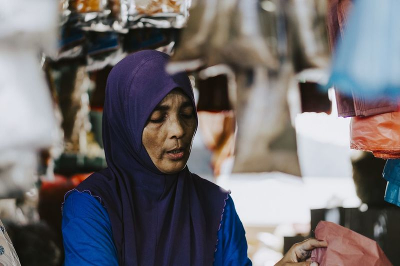 Close-up of woman standing at market stall