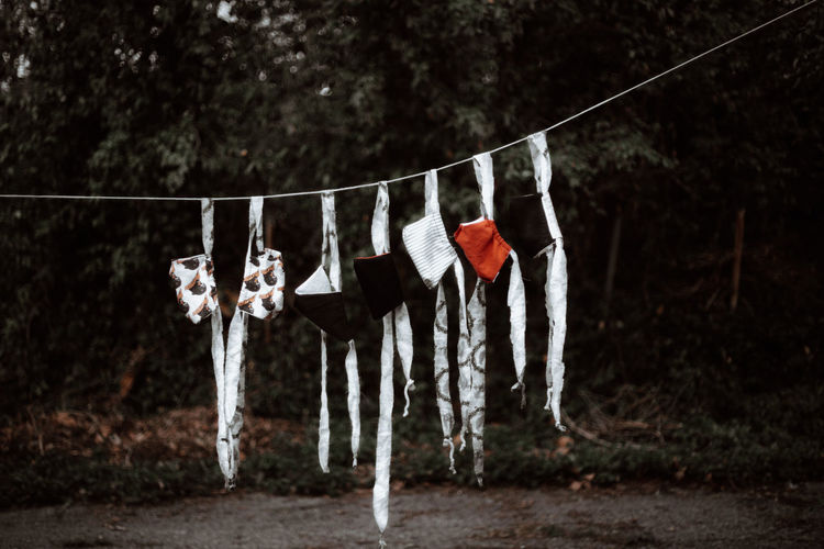 Handmade face masks hanging in a row