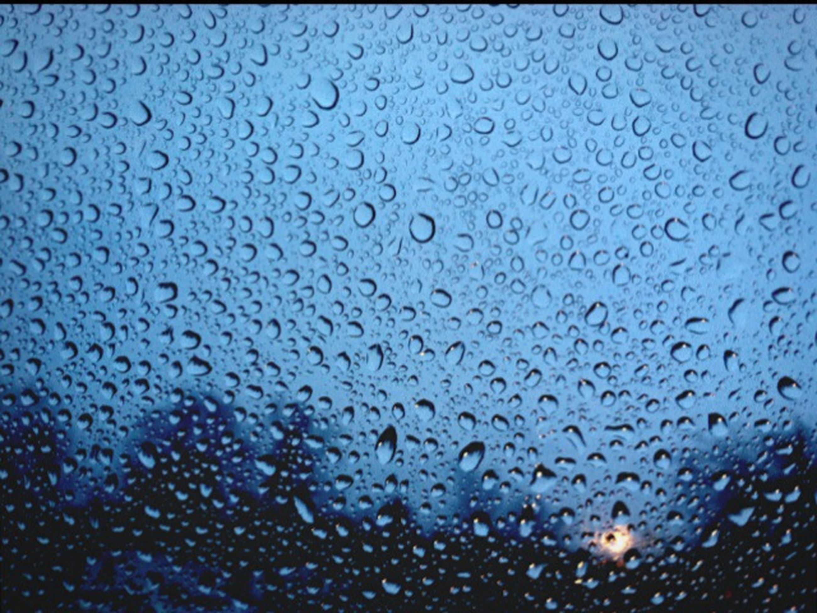 full frame, drop, backgrounds, wet, window, indoors, water, rain, glass - material, transparent, weather, raindrop, close-up, sky, season, glass, no people, pattern, focus on foreground, day
