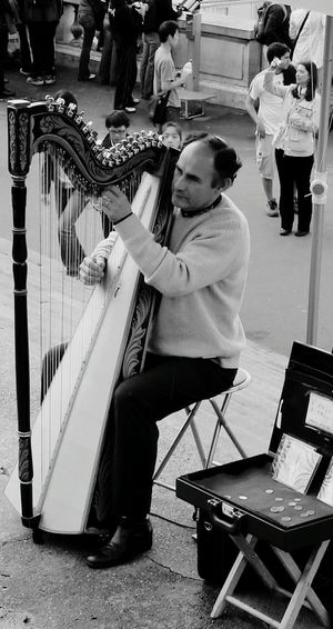 Arpa Music People Arts Culture And Entertainment City Life Real People Outdoors Musical Instrument Paris, France  Montmartre, Paris Occupation
