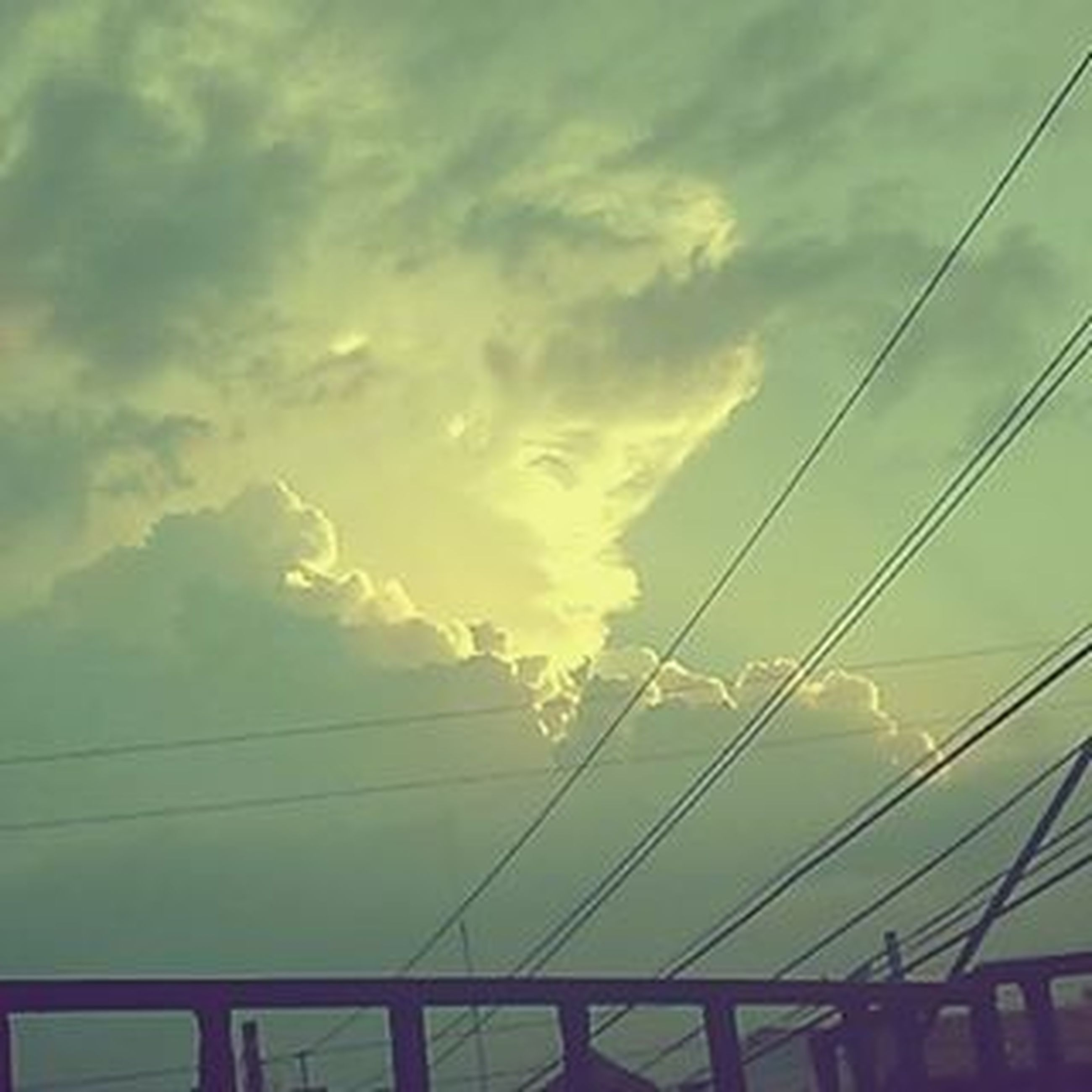 power line, sky, low angle view, electricity pylon, cable, electricity, cloud - sky, power supply, connection, cloudy, sunset, cloud, silhouette, power cable, nature, fuel and power generation, technology, no people, outdoors, beauty in nature