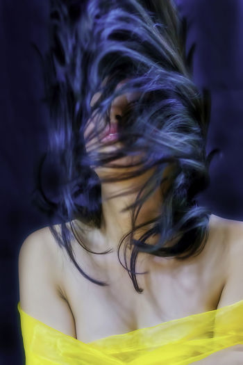 Close-up of woman tossing hair