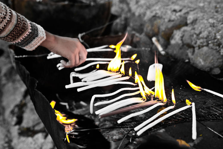 candle light Burning Candle Day Environment Finger Fire Fire - Natural Phenomenon Flame Hand Heat - Temperature High Angle View Holding Human Body Part Human Hand Matchstick Melting Nature One Person Outdoors Preparation  Preparing Food Real People Unrecognizable Person