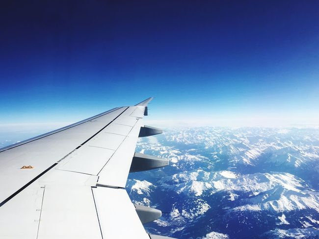 It's the alps From An Airplane Window Nature Blue Snow Scenics No People Beauty In Nature Airplane Aerial View Airplane Wing Landscape Clear Sky Cold Temperature Mountain