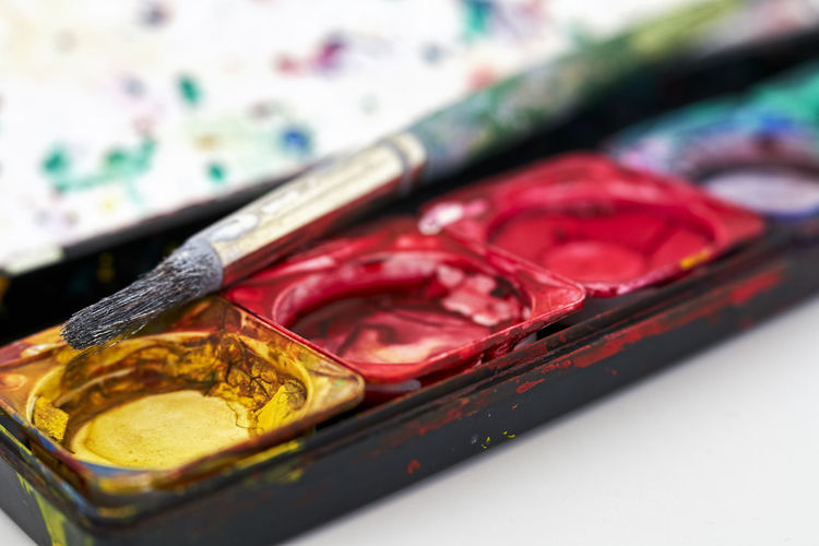 Close-up of paintbrush on palette
