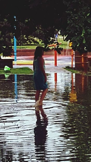 Flood Wading Waterfront Park Mirror Reflection Never Look Back  Anchor Just Keep Swimming Adventure Liquid Dreams Transparency Only Women Adult Rear View Adults Only People Full Length One Person Reflection Outdoors Standing Multi Colored Nature