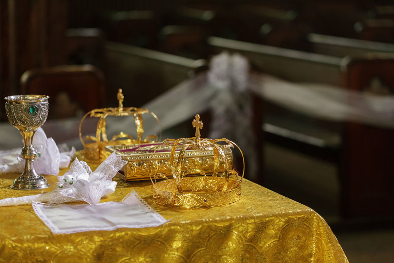 Close-up of crowns on table